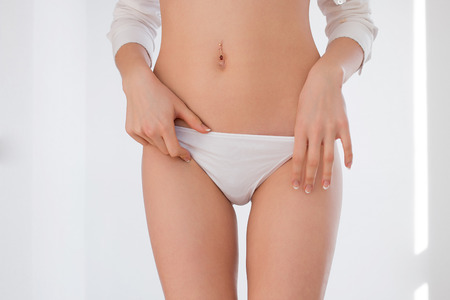 white panties: Young woman in white panties isolated on white background Stock Photo