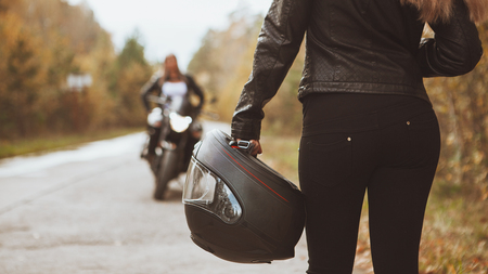 Biker girl rides a motorcycle in the rain. First-person view. Stock Photo - 63277950
