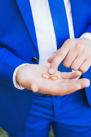 Man is taking off the wedding ring.