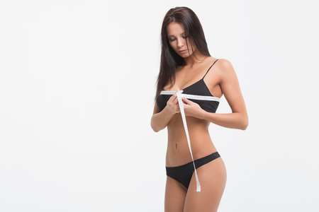 Young beautiful girl measures your body parts of roulette