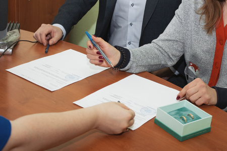 first day: The couple signed their first document. first document Stock Photo