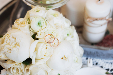 Beautiful wedding bouquet and rings. Wedding day.