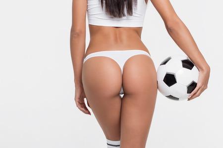 Sexy brunette with a soccer ball Standard-Bild