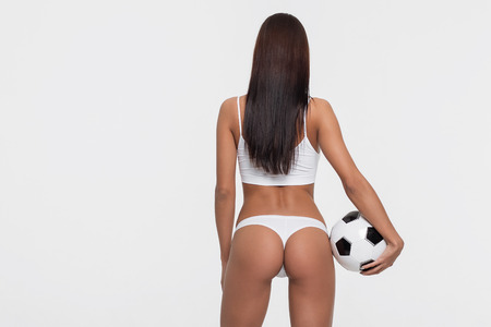 Sexy brunette with a soccer ball Stock Photo