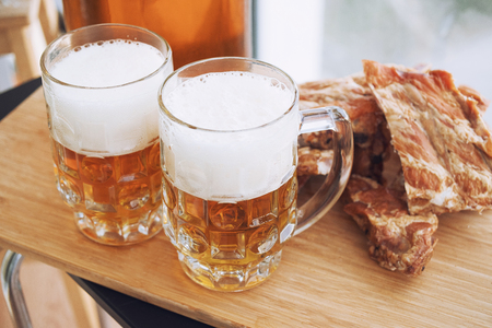 Barbecue pork ribs with beer. On wooden background.