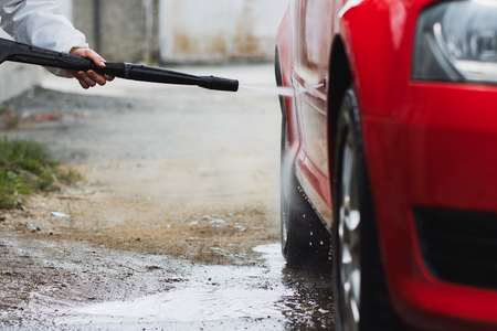 Summer Car Washing. Cleaning Car Using High Pressure Water. Stock Photo