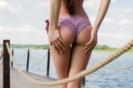 Hot woman in bikini touching buttocks Zdjęcie Seryjne