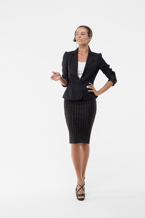 Lady in business dress with head microphone Stock Photo - 106958718