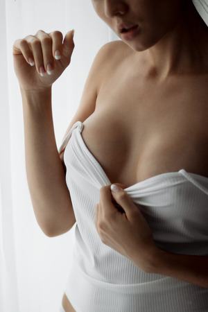 Girl with big Breasts in white lingerie Stock Photo