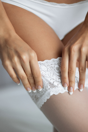 Girl corrects stockings