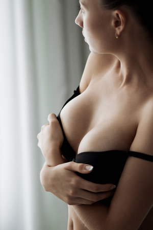 Young beautiful girl with magnificent breasts Stock Photo
