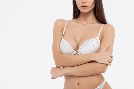 Young beautiful girl shows her gorgeous Breasts. Stock Photo