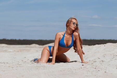 Beautiful young girl in a sexy bikini on the beach