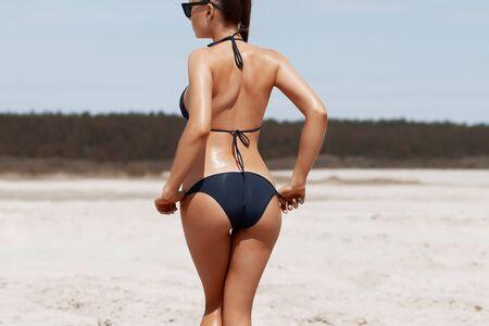 Beautiful young girl in a sexy bikini on the beach.