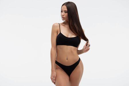 Sexy woman in underwear looking at camera sensually