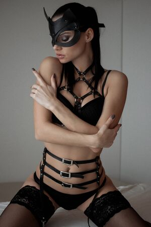 Image of playful catwoman posing looking at camera
