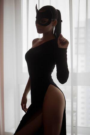 Image of playful catwoman posing looking at camera