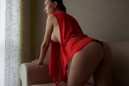 Ass of sensual woman in lingerie in room Stockfoto