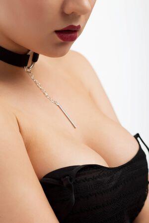 Faceless sensual female posing in studio