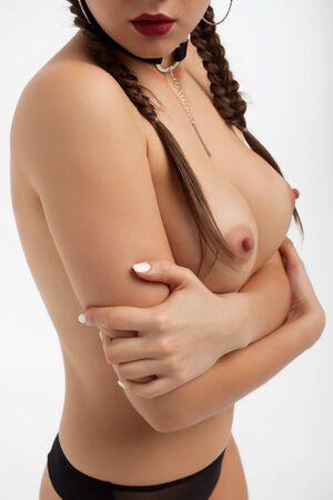 Crop topless seductive woman showing breast 写真素材