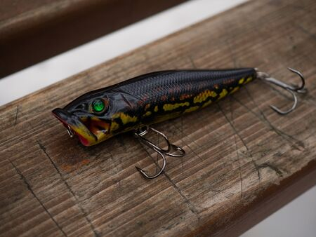 Fishing baits isolated on wooden background