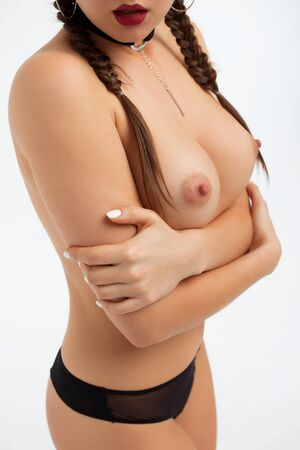 Crop topless seductive woman showing breast Фото со стока