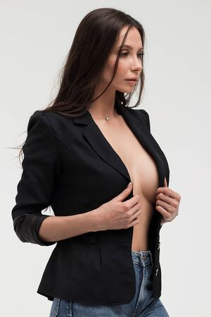 Provocative woman in black suit on body looking away