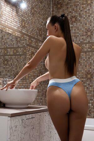 Unrecognizable naked female in bathroom Stock fotó