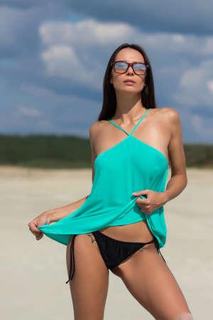Seductive female on sunny day on beach Standard-Bild