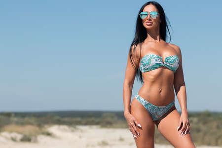 Beautiful woman in swimsuit on beach