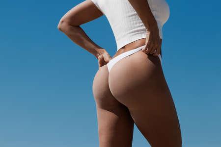 Slim woman with perfect body on beach 免版税图像