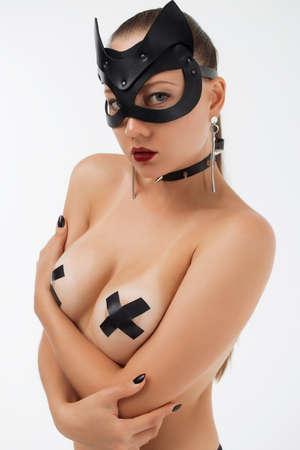 Sensual slim woman in black mask and collar