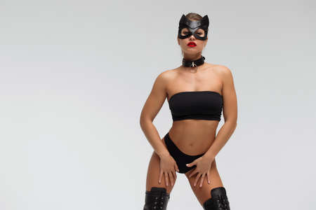 Seductive brunette in BDSM costume