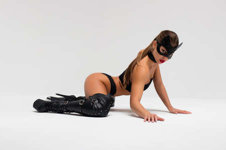 Sensual woman in black mask and underwear