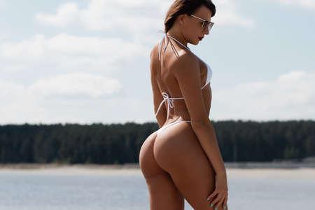 Sensual woman in bikini on beach 免版税图像