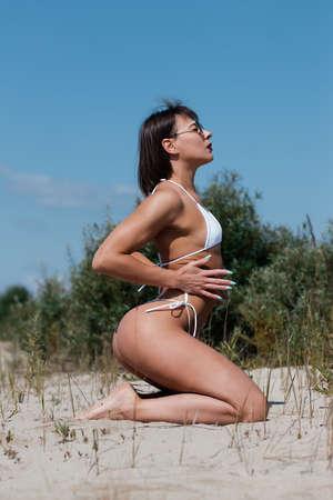 Curvy woman in bikini on beach