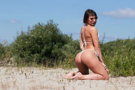 Sexy woman in bikini on beach