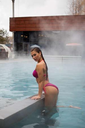 Sexy woman in hot pool 免版税图像
