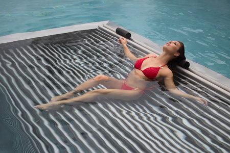 Seductive female resting in pool