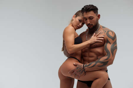 Muscular man hugging topless woman 스톡 콘텐츠