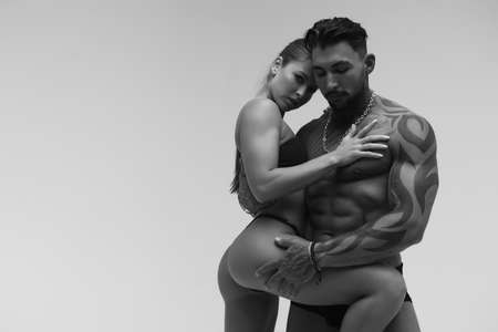 Sexy young couple in studio 스톡 콘텐츠