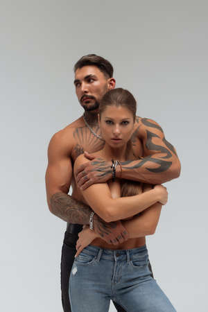 Woman hugging muscular man from behind 스톡 콘텐츠
