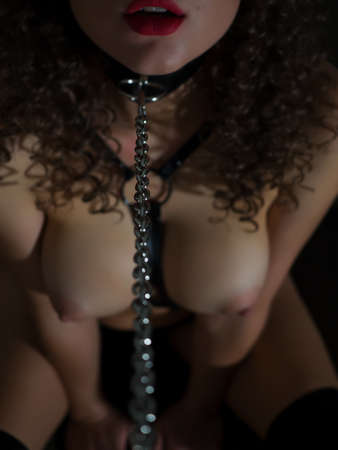 Sexy woman with BDSM chain