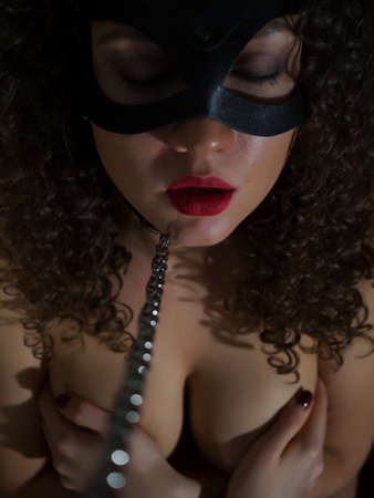 Mysterious woman in BDSM bondage