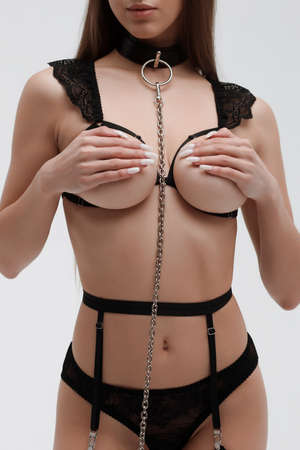Young woman with black tape on