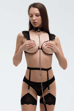 Young sexy woman with black tape on breast