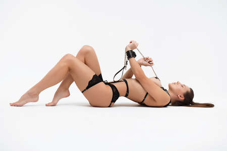 Sexy woman in underwear pulling collar
