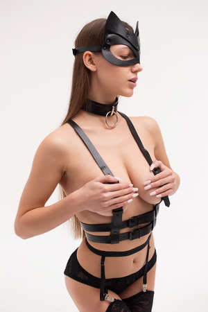 Seductive female in underwear and cat mask