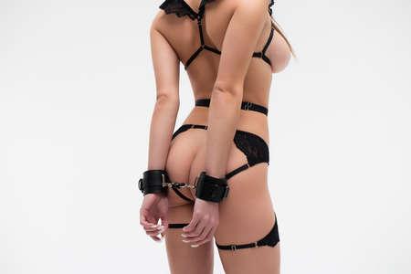Unrecognizable female model in lingerie and handcuffs Banco de Imagens