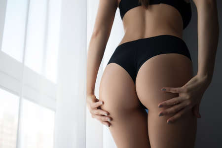 Crop woman with perfect buttocks
